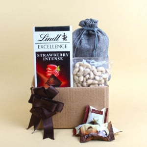 Lindt Excellence Strawberry And Al Alwani Dates With Cashew Nuts